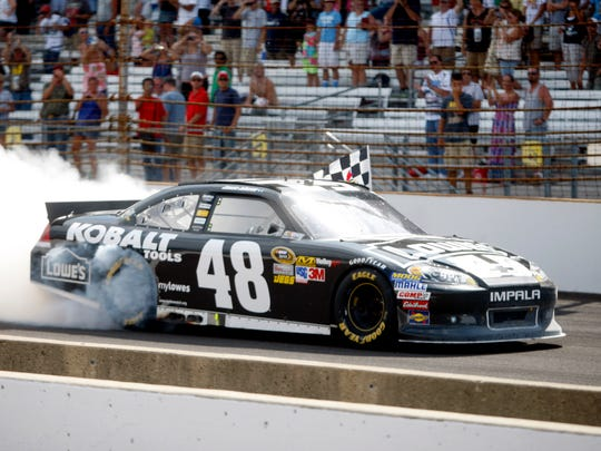 Jimmie Johnson, burns out after winning his 4th Brickyard 400 at the Indianapolis Motor Speedway on Sunday, July 29, 2012. (Kenneth L. Hawkins Jr./ The Star)