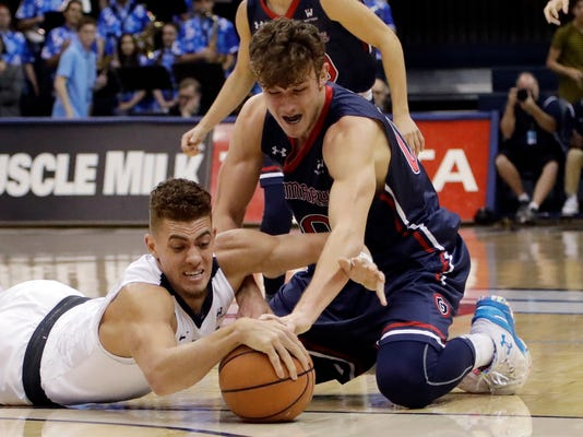 San Diego forward Isaiah Pineiro (0), left, battle St. Mary's guard Tanner Krebs (00) for the ball during the first half of an NCAA college basketball game Saturday, Feb. 3, 2018, in San Diego. (AP Photo/Gregory Bull)