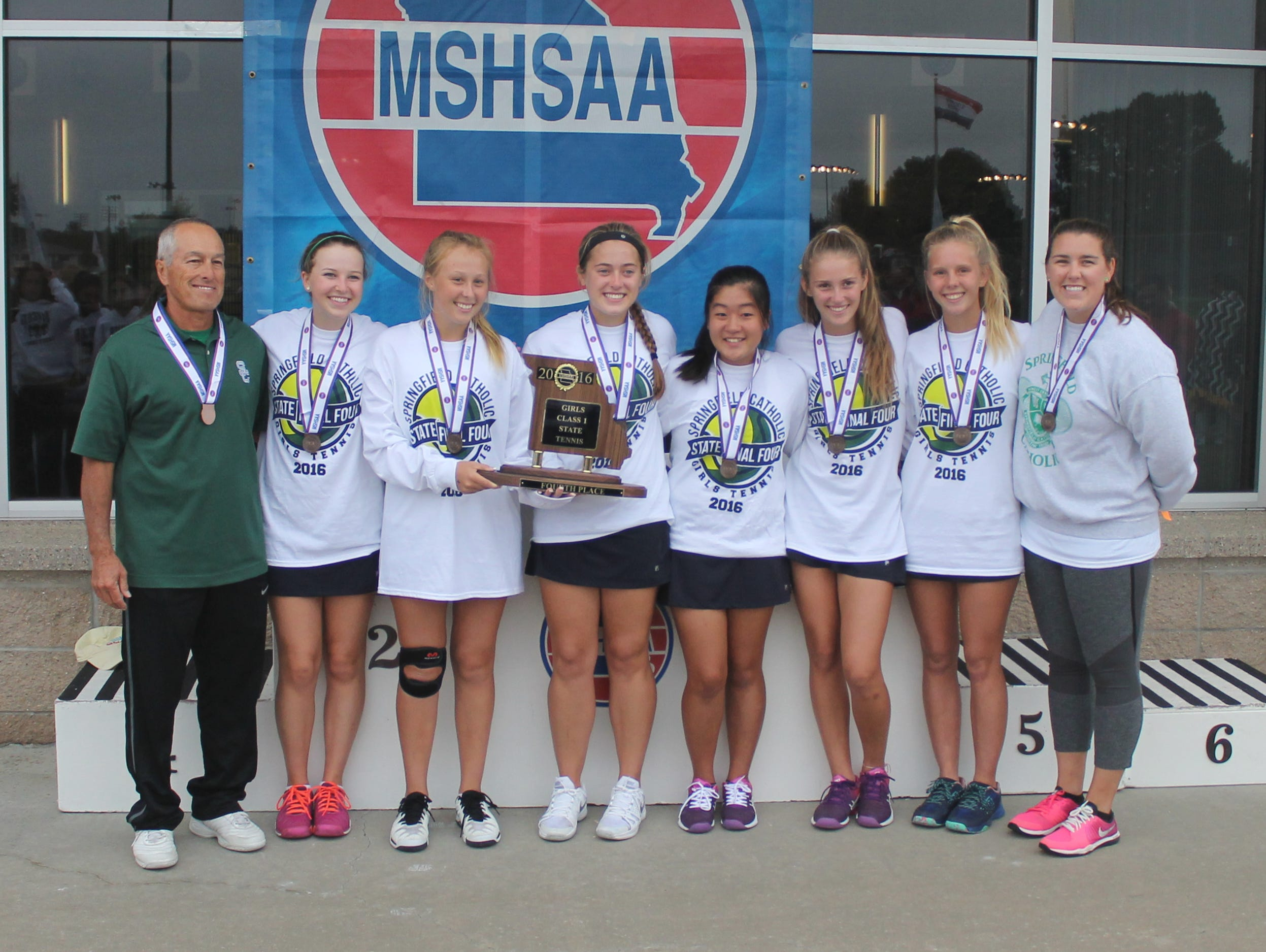 Springfield Catholic's fourth place tennis team with their trophy and medals.