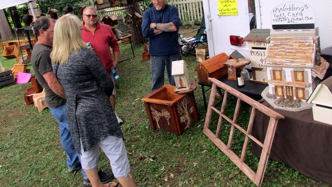 Steve Saumure, right, and Randy Boula chat with guests about some of the crafts of Simply by Nature in September 2018 at the Madison County Craft Festival in Oneida. The festival returns from 10 a.m. to 5 p.m. Sept. 12 and 10 a.m. to 4 p.m. Sept. 13 on the historical society's grounds in Oneida.