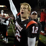 Brian Brohm celebrates after the Cardinals knocked off third-ranked West Virginia in 2006.