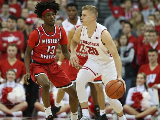 Badgers guard T.J. Schlundt works the ball against