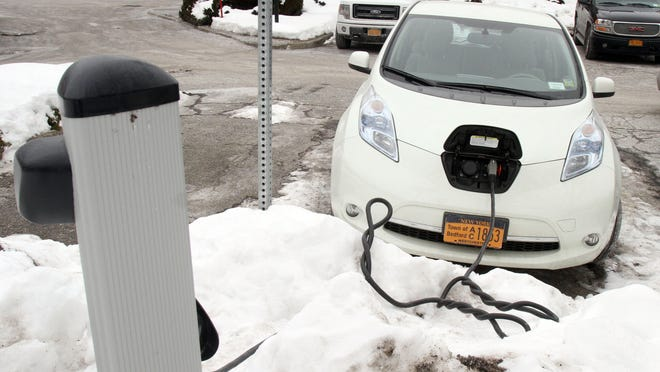 A town of Bedford parking enforcement electric car charges in a station outside Bedford police headquarters on Feb. 21.