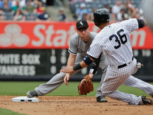 Chicago White Sox Todd Frazier, forces out New York Yankees' Carlos Beltran (36) during the sixth inning of a baseball game Saturday, May 14, 2016, in New York. Brian McCann was safe at first base on the play. (AP Photo/Frank Franklin II)