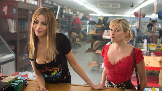 """Reese Witherspoon (right) and Sofia Vergara appear in a scene from """"Hot Pursuit."""""""