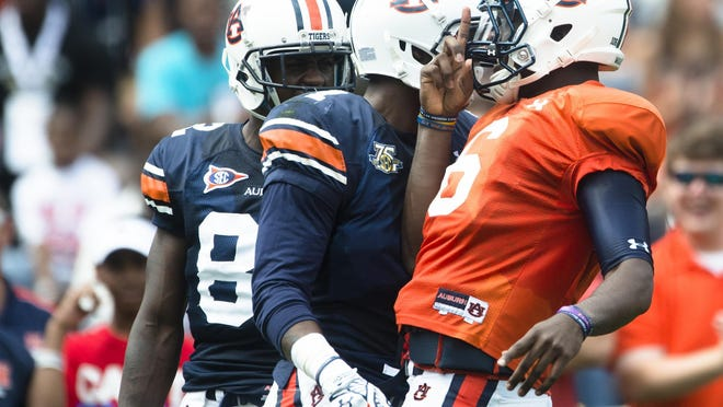 Quarterback and Montgomery native Jeremy Johnson celebrates with wide receiver D'haquille Williams after he received a touchdown reception during the Auburn A-Day spring game on April 18.