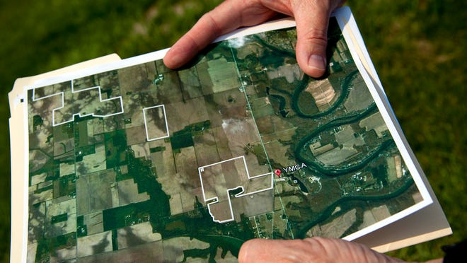 Camp Tecumseh CEO Scott Brosman holds an aerial photo of area around the camp alongside Springboro Road, in Brookston, on Monday, June 24, 2013. The camp is concerned with odor, airborne pathogens and water quality as an area across the road is to be rezoned for a 9,400 hog confined feeding operation.