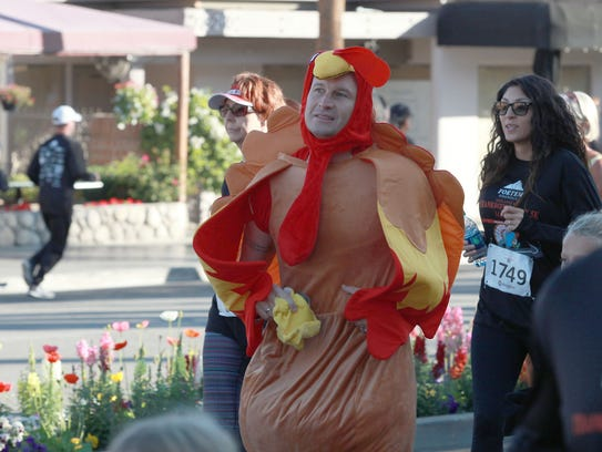People participate in Martha's Village and Kitchen's Thanksgiving Day 5K race on El Paseo in Palm Desert on Nov. 24, 2016.