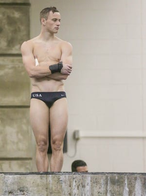 Steele Johnson prepares for a practice dive during a Pre-Olympic Trials news conference at Purdue University's Boilermaker Aquatics Center, June 8, 2016.