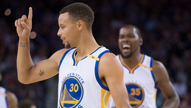 October 21, 2016; Oakland, CA, USA; Golden State Warriors guard Stephen Curry (30) and forward Kevin Durant (35) celebrate after Curry made a three-point basket during the second quarter against the Portland Trail Blazers at Oracle Arena. Mandatory Credit: Kyle Terada-USA TODAY Sports ORG XMIT: USATSI-325984 ORIG FILE ID:  20161021_kkt_st3_009.jpg