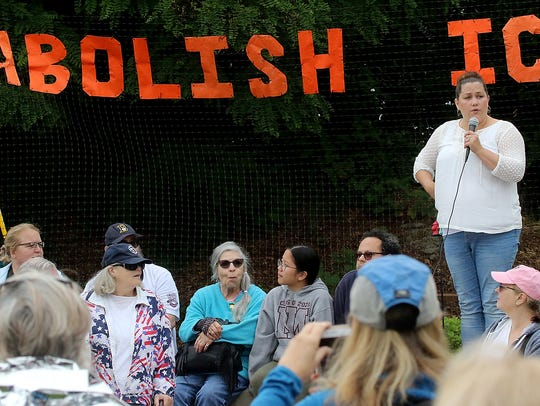 Organizer Megan Jennings addresses the crowd for the Families Belong Together rally at the in Bremerton on Saturday.