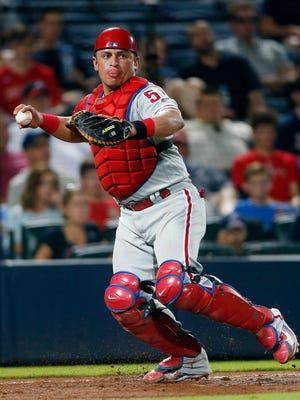 Philadelphia Phillies catcher Carlos Ruiz throws out an Atlanta Braves batter at first base during a baseball game in Atlanta. The NL West-leading Los Angeles Dodgers have swapped catchers with Philadelphia, getting Carlos Ruiz and trading A.J. Ellis to the Phillies. The deal was announced on Thursday, Aug. 25, 2016.