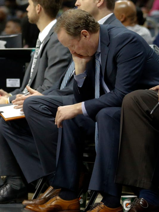 Atlanta Hawks head coach Mike Budenholzer sits on the bench during the second half of an NBA basketball game against the Detroit Pistons Thursday, Dec. 14, 2017, in Atlanta. The Pistons won 105-91. (AP Photo/John Bazemore)