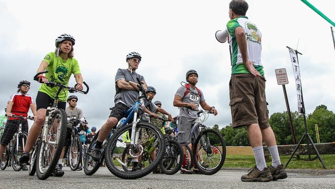 David Epstein, president of the Land Conservancy of New Jersey, right, speaks to riders before the 20-mile ride at the 4th Annual 'Pedal for Preservation' bike event.