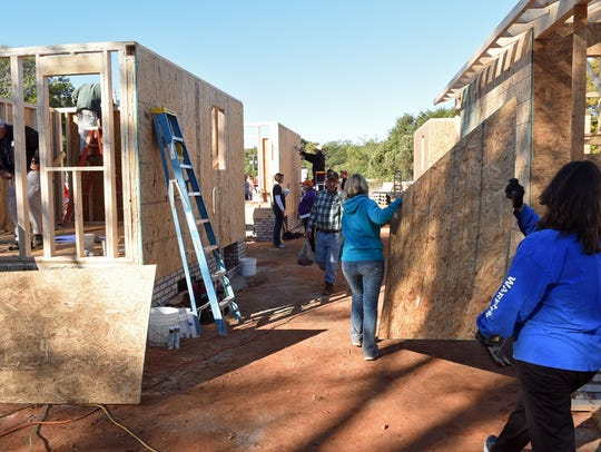 Volunteers work on building tiny houses of Opportunity