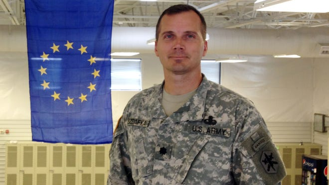 Photo by David Burge Lt. Col. Todd Bzdafka is the new commander of the 80th Civil Affairs Battalion at Fort Bliss. He is seen in front of the European Union flag at the battalion headquarters.