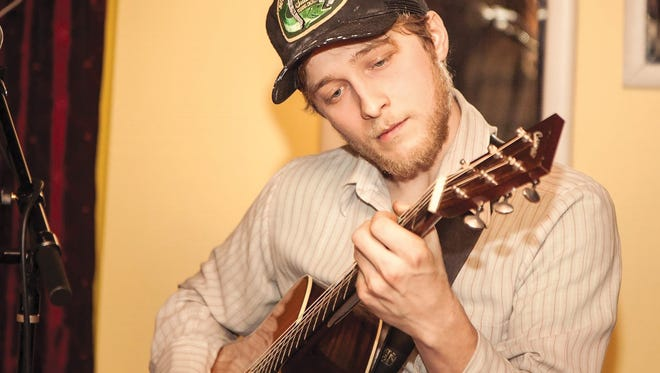 Aaron Lipp, who has appeared on the Leno and Letterman shows, playing at Roots Cafe in Naples.