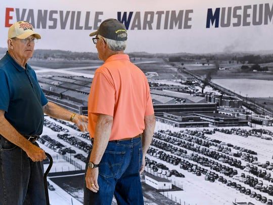 Veterans Ralph Wallace (left) and Ric Jessup talk as