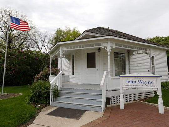 The John Wayne birthplace house, which was once crammed with memorabilia and movie artifacts, will be restored to look more like its 1907 condition, now that the new John Wayne Birthplace Museum opens around the corner in Winterset, Iowa.