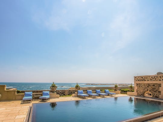 The pool overlooking the ocean offers stunning views.