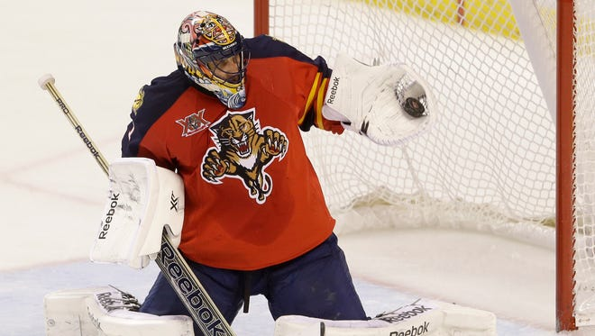 Florida Panthers goalie Roberto Luongo makes a save during the third period of an NHL hockey game.