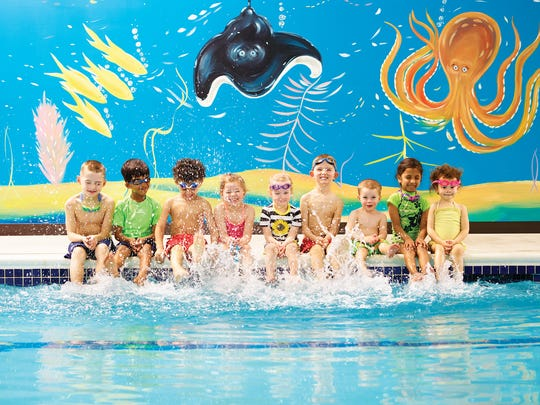 A group of children enjoy their swim class at Goldfish