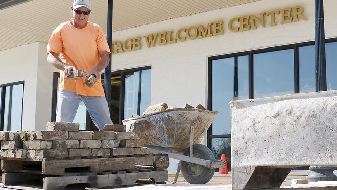 Walley Davis, with New Life Masonary, loads bricks for interior work at the Arkansas Colleges of Health Education - Village Welcome Center on Monday, Sept. 21, 2020. The Village is located across from ACHE in Chaffee Crossing. It features residential and commercial spaces promoting a healthy lifestyle. The area has access to restaurants, walking trails, a lake, sports courts and entertainment facilities.
