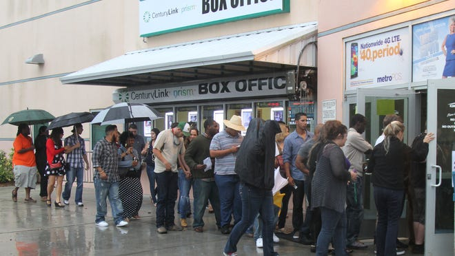 Visitors to Germain Arena line up outside the box office as the doors open for a performance by comedian Kevin Hart on Friday evening.