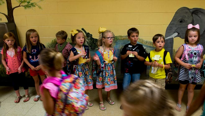 Montgomery Central Elementary students line up inside as they wait for their parents to pick them up after their first day on August 7, 2017.