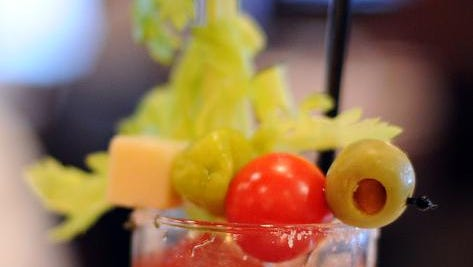 A Bloody Mary topped with celery, olive, tomato, pepper and cheese at the build your own Bloody Mary station, Sunday, December 15, 2013, at Palomino Restaurant & Bar.