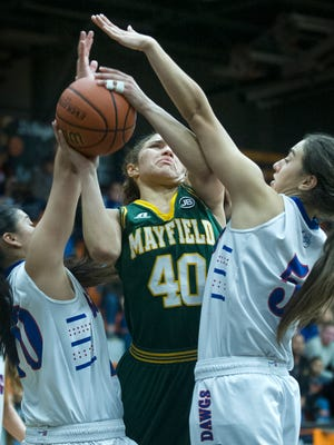 Mayfield's Kendra Butler goes up for a shot under extreme pressure from Las Cruces High's Val Valtierram, left, and Jayden Perez, right, during the Holiday Hoopla Tournament semifinals earlier this season. The two rivals meet tonight at Mayfield High School.
