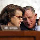 Vice Chairman Sen. Dianne Feinstein, D-Calif., left, and Chairman Sen. Richard Burr, R-N.C., talk during a recent meeting of the Senate Select Committee on Intelligence. Both support ensuring that law enforcement has access to smartphone data.