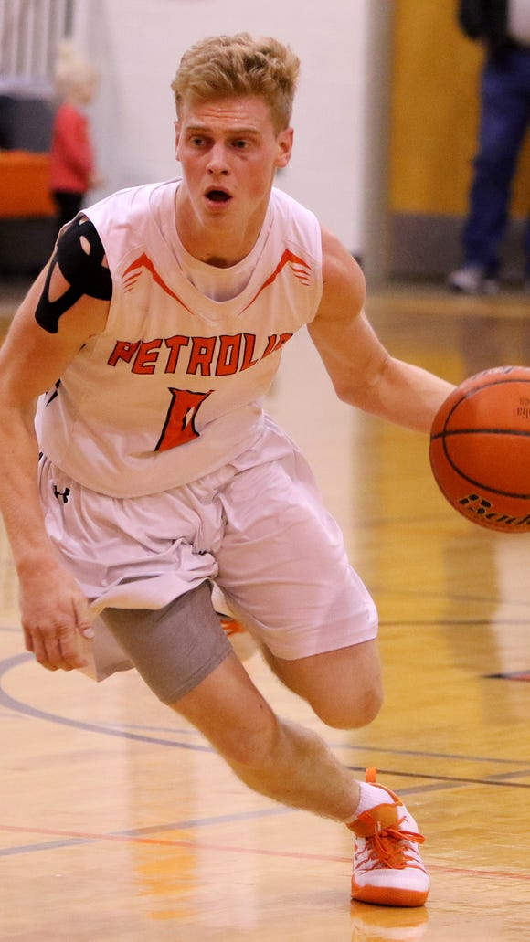 Petrolia's Dane Williams drives toward the basket in the game against Electra Tuesday, Jan. 24, 2017, in Petrolia. Petrolia defeated Electra 49-42.