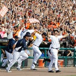 Detroit Tigers players run out of the dugout to celebrate after clinching the American League Central Division on Sunday. Tickets were still available for the Tigers' home games in the American League Division Series.