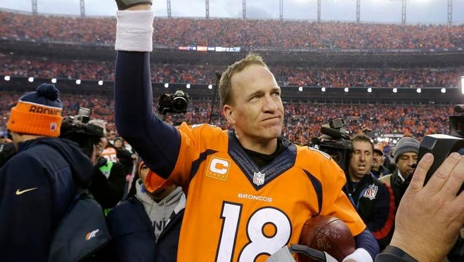Peyton Manning waves to the Denver crowd after Sunday's 20-18 win over New England in the AFC Championship game.