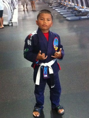 "Described as a ""high achiever"" by family members, Tristan Dwayne Acfalle, 9, has excelled during his young career in Brazilian jiu-jitsu. Tristan, who lives in Hawaii with his parents, former Guam residents Lance and Lorrie Acfalle, has practiced the sport for just over a year. So far, Tristan has racked up a number of accomplishments – winning first place in both Gi and No-Gi categories at North American Grappling Association tournaments in March and October, as well as taking gold medal in Gi and silver in No-Gi at the Hawaii Triple Crown tournament in the summer. Tristan is a grey and white belt, and trains at the UFC Gym BJ Penn in Honolulu, according to his parents. Tristan's first cousin is Guam mixed martial arts fighter Kyle Aguon. If you have an off-island athlete you'd like PDN sports to feature, email us their story and information to sports@guampdn.com."