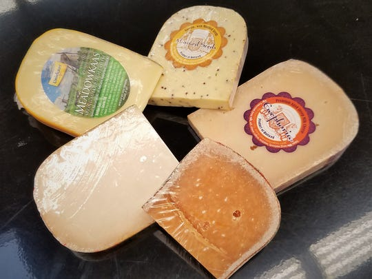 Gouda cheeses are insanely popular and range from the dark and crumbly Gouda Pittig on lower right, through lighter and fresher cheeses, to ones made with goat or sheeps' milk