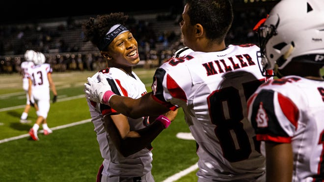 Springfield's Rashad Rochelle (8) and Springfield's Shane Miller (85) celebrate along the sidelines as the Senators take the lead against Sacred Heart-Griffin late in the fourth quarter at Ken Leonard Field, Friday, Oct. 4, 2019, in Springfield, Ill.