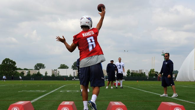 Titans quarterback Marcus Mariota (8) throws a pass during quarterback drills  at St. Thomas Sports Park Friday.