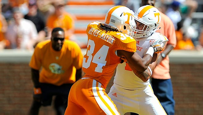 """Jalen Reeves-Maybin (34 and Jalen Hurd (1) go toe to toe in the """"Circle of Life"""" during the University of Tennessee Orange and White game at Neyland Stadium. Saturday April 12, 2014, in Knoxville, TN."""