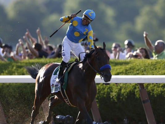 Jockey Victor Espinoza, aboard American Pharoah, celebrates after wining the 147th running of the Belmont Stakes as well as the Triple Crown, in Elmont