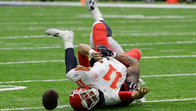 Kansas City Chiefs quarterback Alex Smith (11) fumbles the ball as he is sacked by Houston Texans outside linebacker John Simon (51) during the first half of an NFL football game Sunday, Sept. 18, 2016, in Houston. Houston recovered the ball.