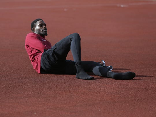 Former Wakulla High state champion high jumper Corion Knight spent three years at an NAIA school, where he became a two-time national champion, and now heÕs at Florida State learning from and jumping next to the best in the country. Here Knight rests dafter practice at FSU's Mike Long Track Facility Jan 29.