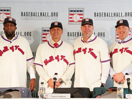 Baseball Hall of Fame inductees, from left, Vladimir Guerrero, Trevor Hoffman, Chipper Jones and Jim Thome, right, pose during news conference, Thursday, Jan. 25, 2018, in New York. (AP Photo/Frank Franklin II)