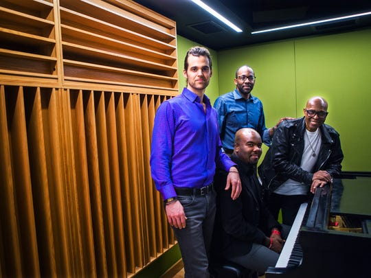 Artist Matthew Michael, from left, president Tony Alexander, executive Hamilton Hardin, at piano, and David Porter pose for a portrait inside Made in Memphis Entertainment, a new music studio opened by Porter, a retired Stax songwriter. The $5 million music studio is at 400 Union Ave.
