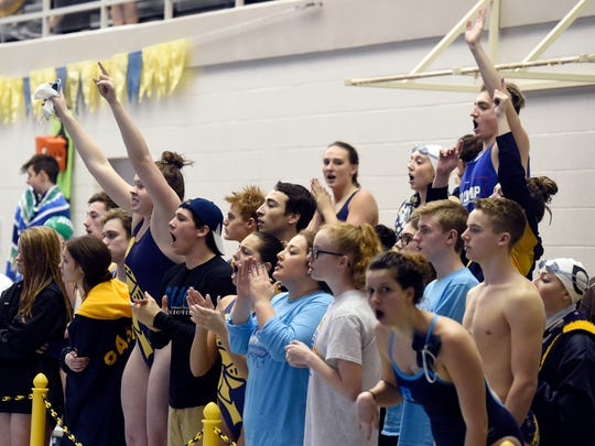 Castle swimmers cheer on 200-yard freestyle relay team during the SIAC meet at Castle High School on Saturday.