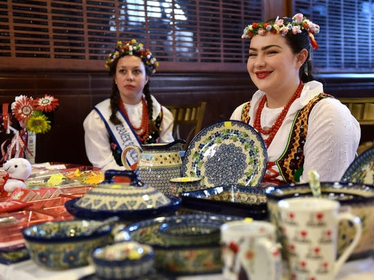 From left, Erica Geml, 16, and Katrina O'Higgins, 15, both of Warren, sell Polish items at the Polish American Cultural Center.  The young ladies are members of the Polish Women's Alliance Zamek Dance Troupe.