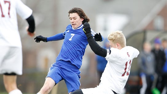 Pearl River's Craig MacDonald (7) fights for possession