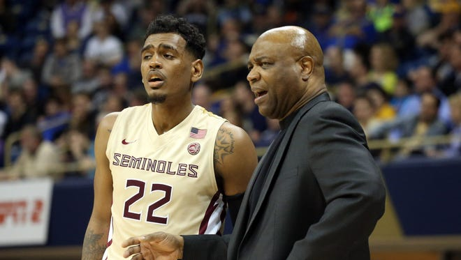 Florida State guard Xavier Rathan-Mayes (22) and head coach Leonard Hamilton (R) need to discover the source of the Seminoles road woes sooner rather than later.