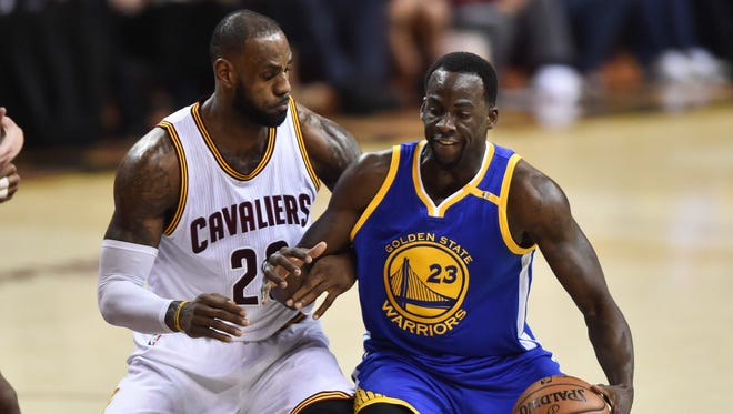 Cleveland Cavaliers forward LeBron James (23) defends Golden State Warriors forward Draymond Green (23) during the second quarter in Game 3 of the 2017 NBA Finals.